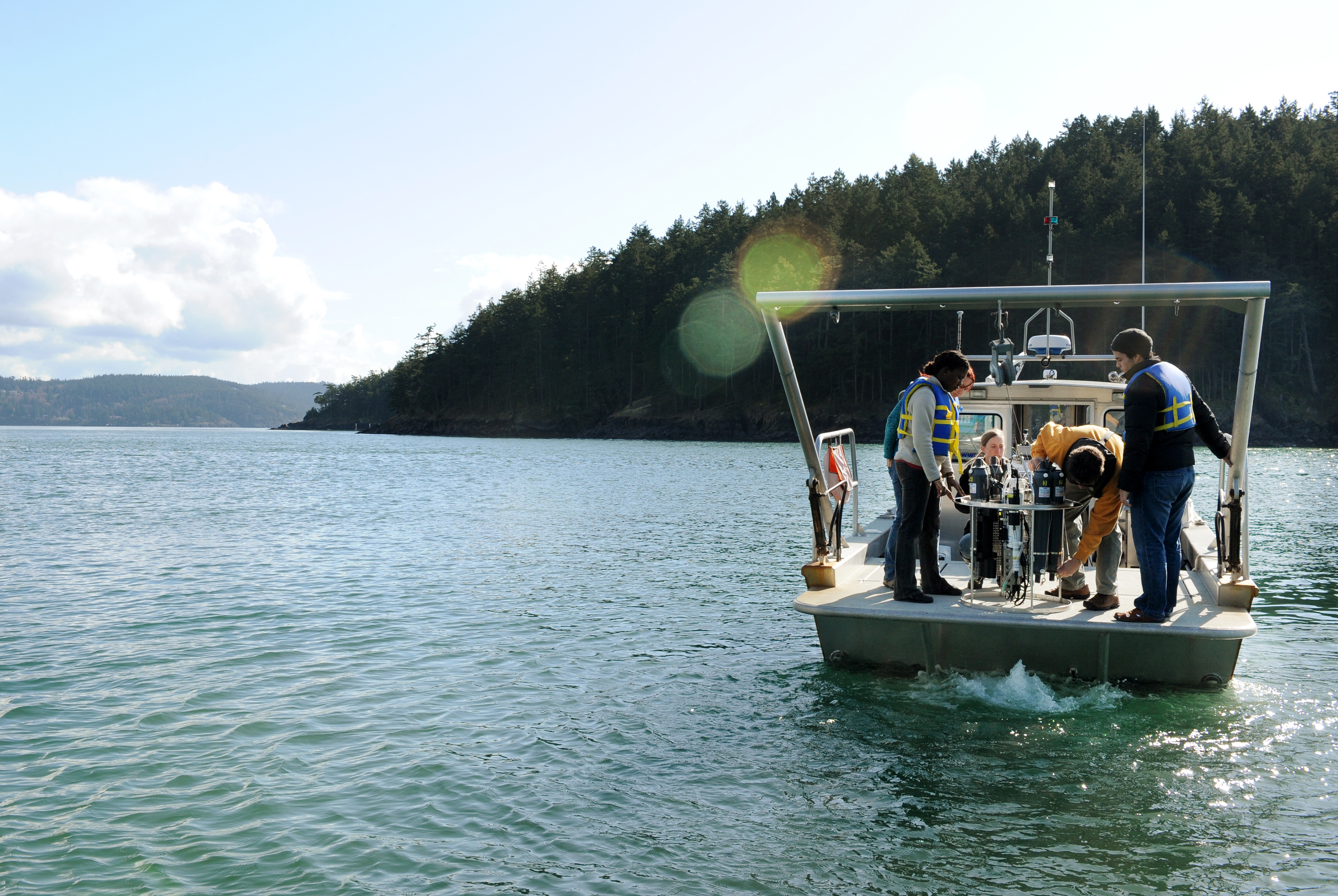 students working on a research vessel in the Salish Sea